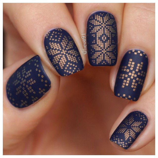 """♀️ Hey everybody! It's me, Anja aka @lieve91⠀ ⠀ Welcome to my #MYLtakeover today I will show you different designs that I created with the MYL plates! I think they are perfect for cold winter days ❄️️ Hope you enjoy this takeover! ⠀ ⠀ I love dark colors! And this dark blue polish called """"I love my blue jeans"""" by @essence is one of my favs for winter❤️️ I used a golden Ginger Rust polish for stamping by @moyou_london and for the pattern, I used their plate number 31 from Festive Col..."""