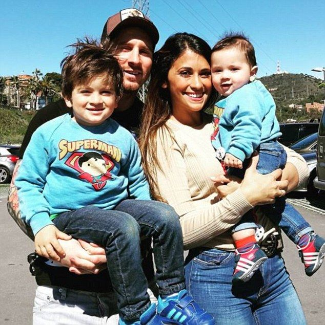 Family man: Lionel Messi with his girlfriend Antonella Roccuzzo and their children Thiago ...