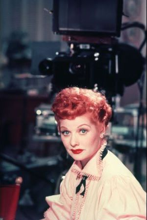 """Oddly enough, while most people associate Lucille Ball with blazing red hair, she wasn't a natural redhead. A natural brunette, she colored her hair blonde as a starlet in the 1930s and 1940s. To look better in front of the television camera, she dyed it red and often wore a wig on the set. She stayed with that hue from the 1950s onward. (She once joked that she was keeping the economy of Egypt afloat with her annual orders of henna."""