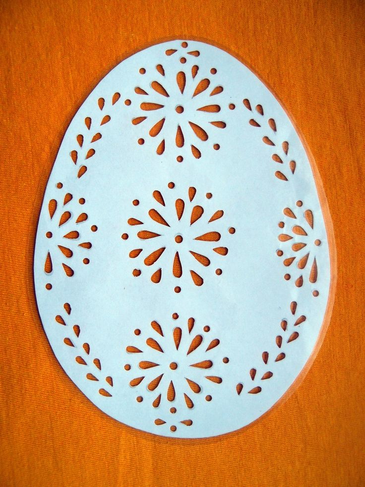 Velikonoční vystřihovánka - Kraslice Papírová vystřihovánka zatavená ve folii - pro opakované použití. Velikost vystřihovánky (i s folií) 11,5 x 15,5 cm. Vhodné např. jako výzdoba do okna.