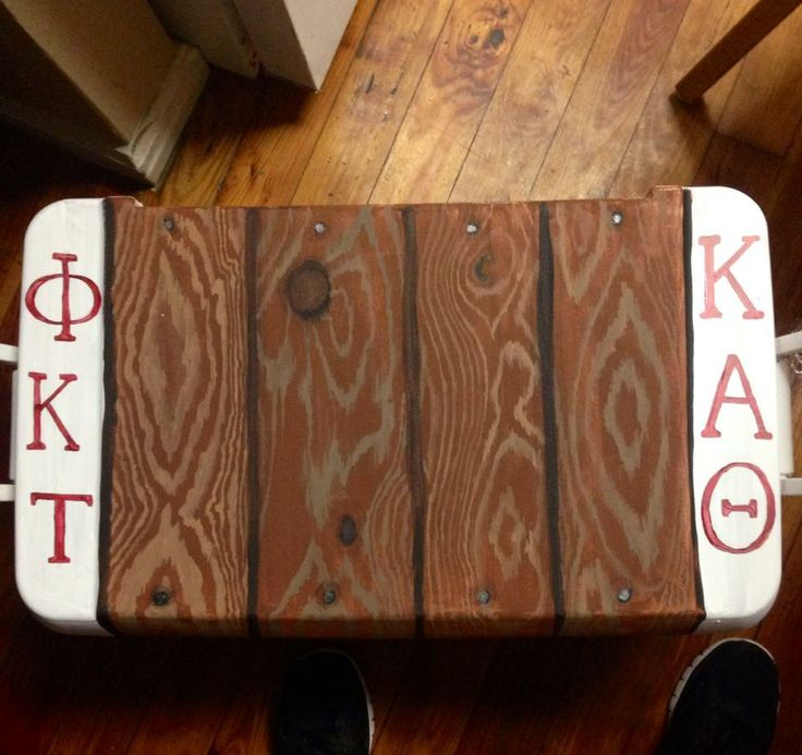 Best phi kappa tau frat cooler faux wood painting I have ever seen. what a great Theta she must be to give this to her boyfriend. Sweet frat daddy painted cooler gift