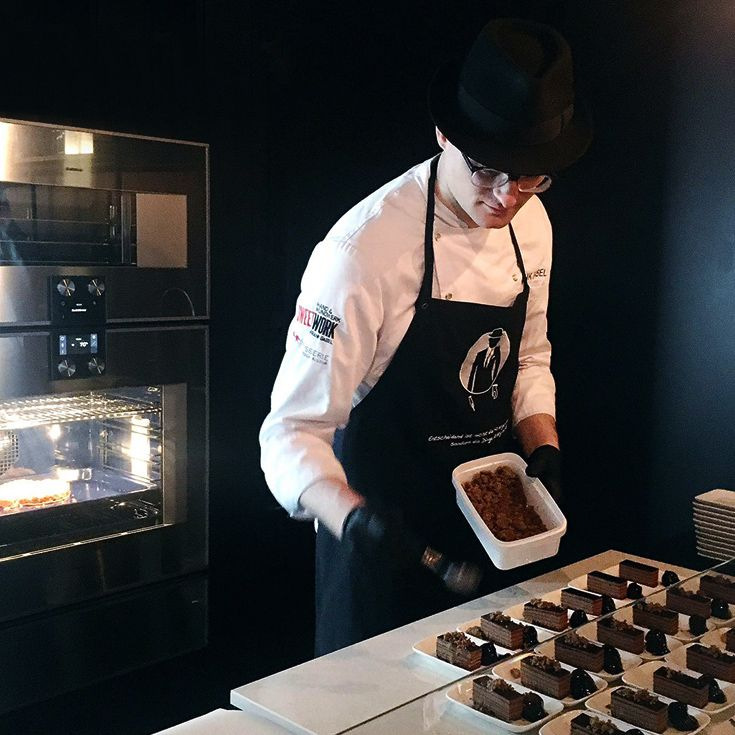 The Gaggenau Living Kitchen booth treated visitors to a petit café experience: inventive and delicately balanced delicacies to accompany the coffee from the new fully automatic espresso machine. Frank Gabel, the celebrated hatted pâtissier from Pâtisserie Walter and Sweetwork Hand & Mundwerk, is seen adding the final touches to chocolate cake with a cassis fig and chocolate crumble. Frank believes chocolate goes with everything.