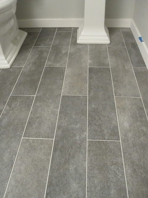 VARIGATED DARK GRAY TILE FLOORS Wide plank tile for bathroom. Great grey