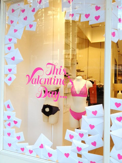 Easy valentine's day display- one would simply replace the risque women's lingerie(is that a bunny tail on those panties?) with children's books