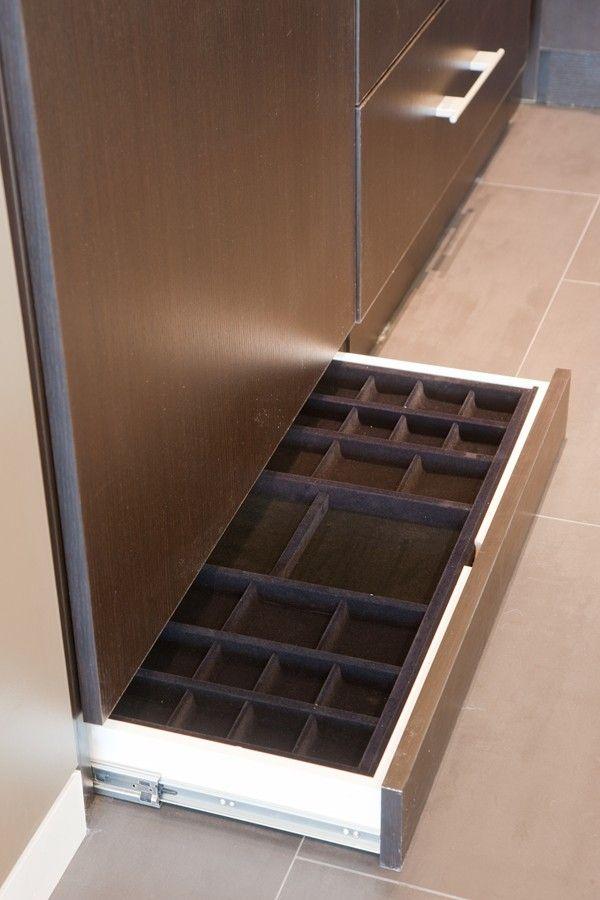 A hidden toe-kick jewelry drawer