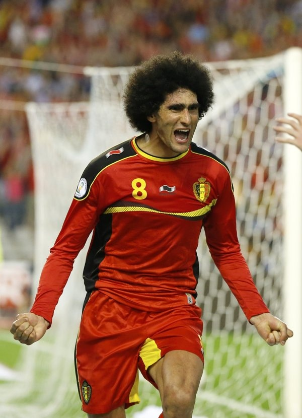~ Marouane Fellaini of the Belgium National Team celebrating his goal against the Serbia National Team in the World Cup Qualifier ~
