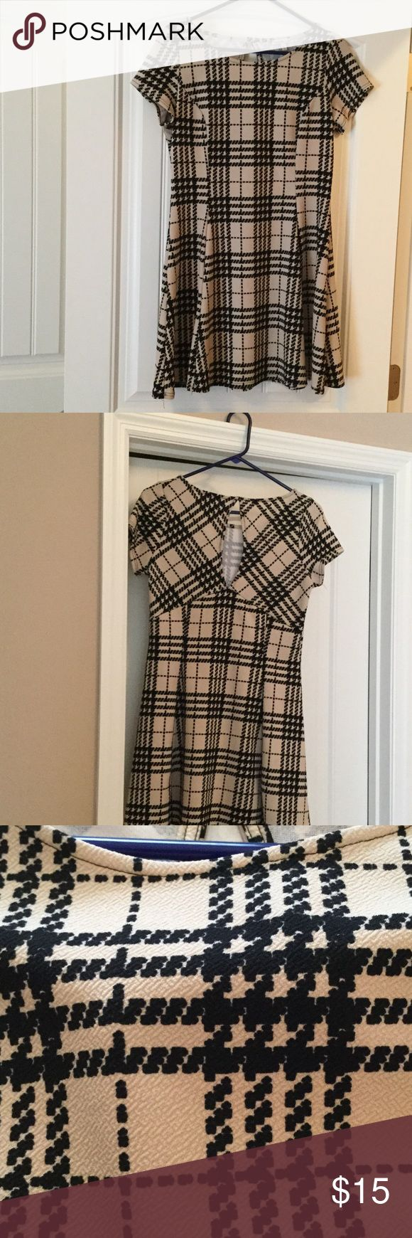 Charlotte Ruse dress size X large Cute black and cream colored dress with a keyhole back, size extra large Charlotte Russe Dresses