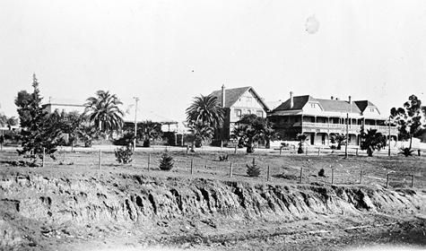 The Grand Hotel in Mildura.  The railway cutting in is the foreground. Mildura, Victoria, ca. 1930  Hugh stays in the Mildura Hotel, which may have looked like the Grand.