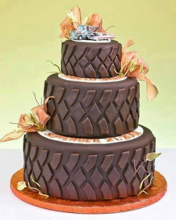 "Camo/mudding wedding cake! Love the tow truck Mater on top because my fiancé happens to be a ""hooker"". Customize flowers to wedding color"