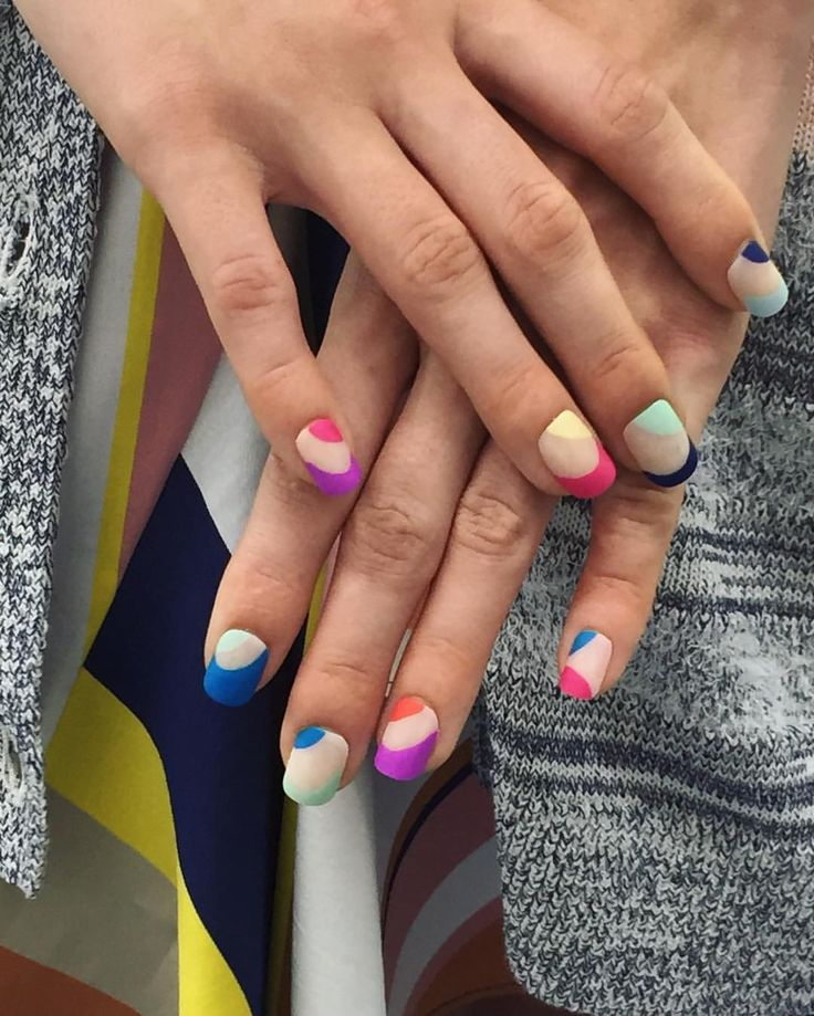 Today's @tanyataylor runway nail look featured 9 different #MorganTaylor shades: Water Baby, Orange You Glad, New School Nude, West Coast Cool, Tropical Punch, Mint Chocolate Chip, Ahead Of The Game, Tokyo A Go Go, Sweet Escape, Deja Blue, with Mattes A Wrap Top Coat. Lead nail artist @ginaedwards_  See more on @nailsmagazine's Snapchat as we takeover for #NYFW! #NailedNYFW