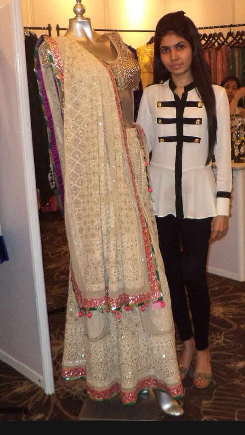 Chikankari lehenga but perhaps with a dark blue border