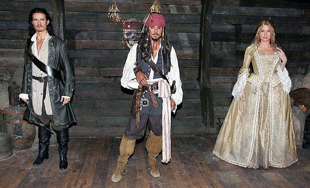 Waxwork models of Orlando Bloom as Will Turner, Johnny Depp as Captain Jack Sparrow and Keira Knightly as Elizabeth Swan from Pirates of The Caribbean form part of an interactive attraction at Madame Tussauds in London. A.P.H