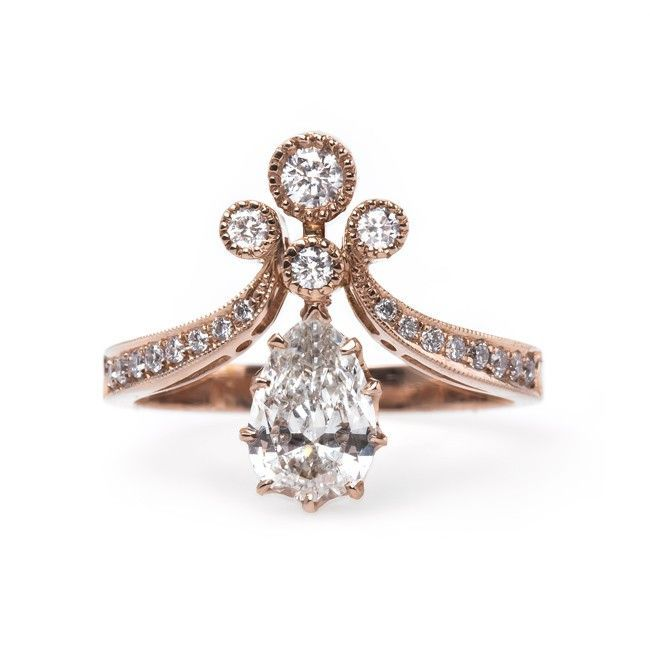 Vintage-inspired rose gold engagement ring with a pear shaped diamond // Rose Gold Tiara from Trumpet & Horn // $5,700