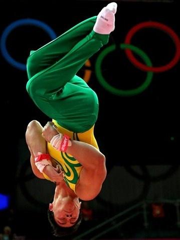 Sergio Sasaki Junior of Brazil dismounts the rings in the Artistic Gymnastics Men's Individual All-Around final