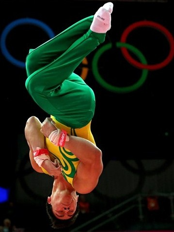 Sergio Sasaki Junior of Brazil dismounts the rings in the Artistic Gymnastics Men's Individual All-Around final