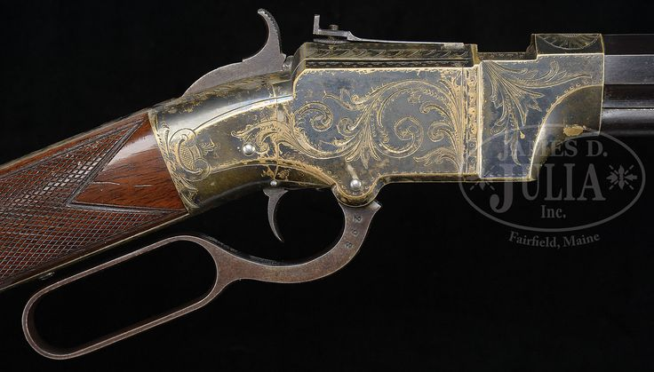 """SPECTACULAR SILVER PLATED HOGGSON ENGRAVED VOLCANIC RIFLE WITH THE VERY RARE AND DESIRABLE 25 INCH BARREL AND IN SUPERB CONDITION. Cal. 41. 25"""" bbl with 2-line address. Factory engraved silver plated receiver with rare checkered stock. All screws are numbered to gun. Buttplate is engraved en suite. All numbers match. Cartridge plunger in magazine is missing. This one in particular has been in the home of Ray Bentley for many years. The 25"""" barrel rifle is the rarest and most desirab..."""