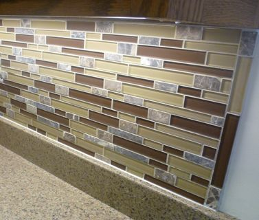 pictures of ends of glass tile backsplashes like many