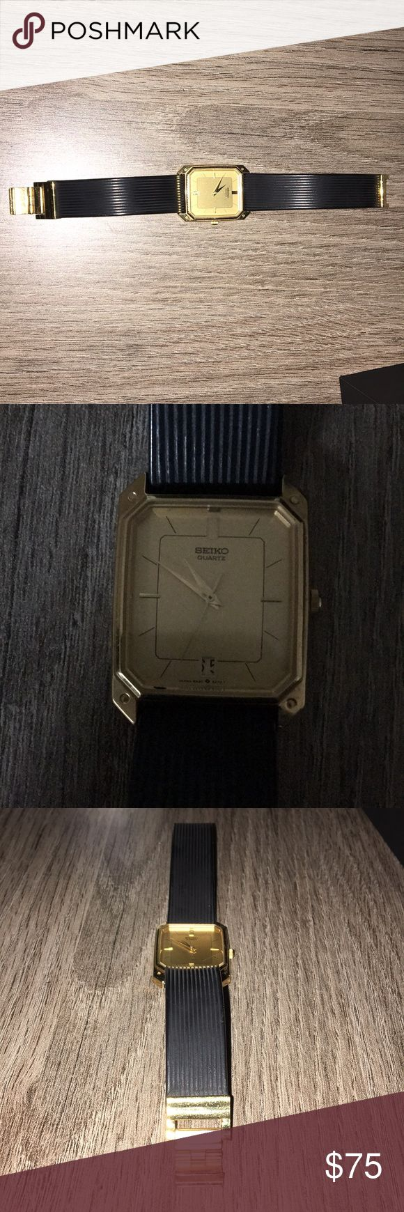 Seiko Watch: Gold & Black Band (VERY LOW PRICE) Seiko Gold & Black colored watch. Durable watch with durable band. It is no longer on the market and is limited edition. In great condition. Shines like new and wasn't worn very often. AMAZING DEAL. Seiko Accessories Watches