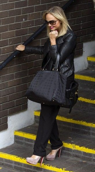 Singer and radio presenter Emma Bunton leaves the ITV Studios in London on October 4, 2013.