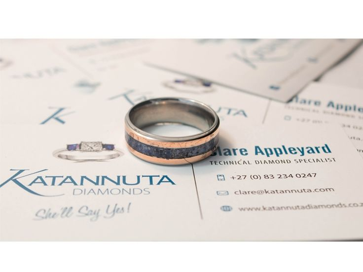 If you're looking for a statement ring, this is it. Featuring titanium, crushed gemstones and copper, this men's titanium ring is unique in South Africa. Measuring 8.5mm wide, this flat-profile ring displays a 3mm gemstone inlay cushioned between 2 copper inlays, each 1.5mm wide. Manufactured to order, this ring is available up to size Z +6 and is priced from R1,900, depending on ring size. Featuring crushed gemstones of your choice, the gem inlay can feature one colour gemstones, or a…