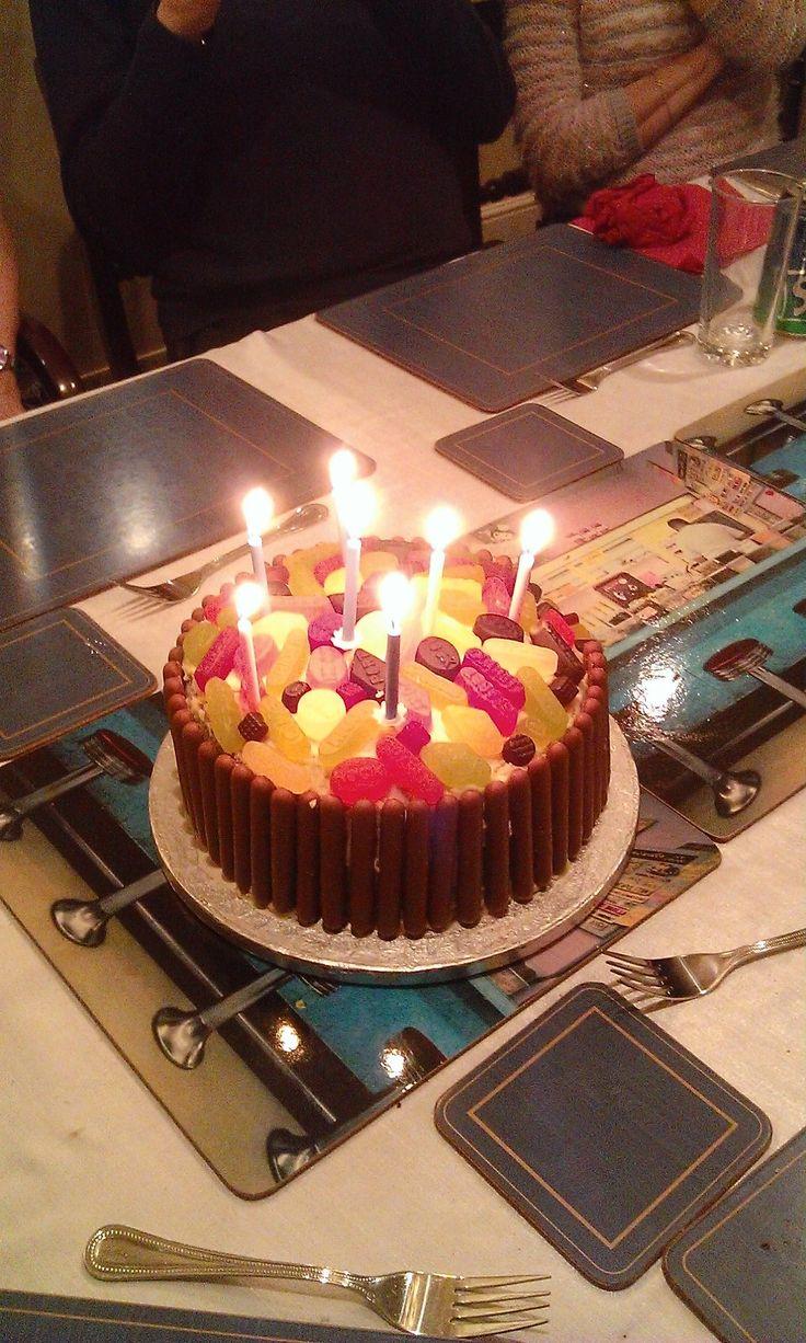 Happy birthday Mom. Chocolate fingers and wine gum cake.