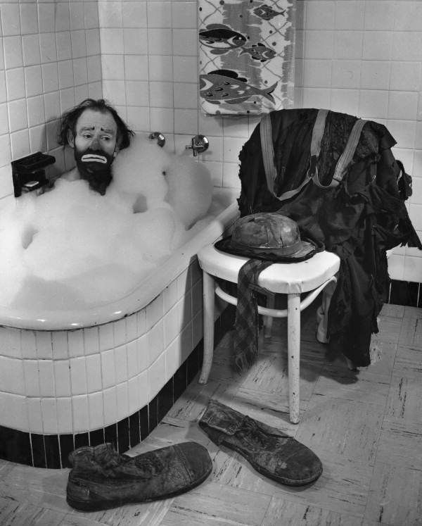 Ringling Circus clown Emmett Kelly in a bubble bath.  Job description: that would be Clown, a job that will never go away!!