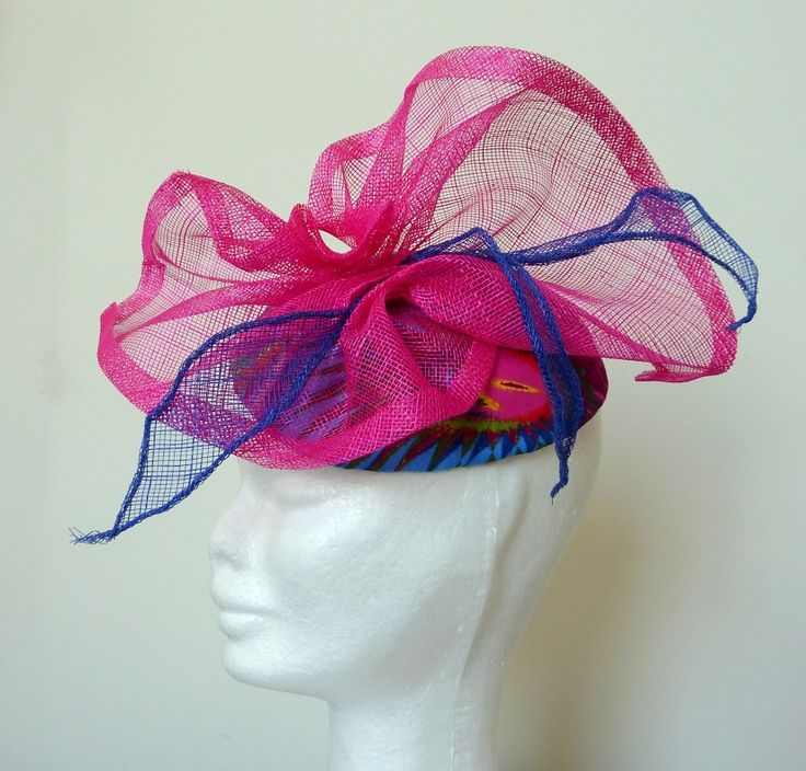 Race hat/cocktail hat pink Peacok patterned pink and blue handblocked base. Royal blue and fuschia pink sinamay trim.