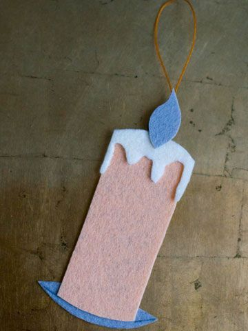 Relive the Victorian-era tradition of a tree decorated with candles -- but do it the safe way, with this adorable felt ornament. How to Make It: 1. Cut a rectangle from stiff felt. Cut a wick, melted wax, and a holder to size to fit the rectangle. If desired, use a stencil, cookie cutter, or a candle on an old Christmas card as a template. 2. Glue the cut-out shapes to the rectangle. 3. Hot-glue a hanging loop to the back of the ornament.