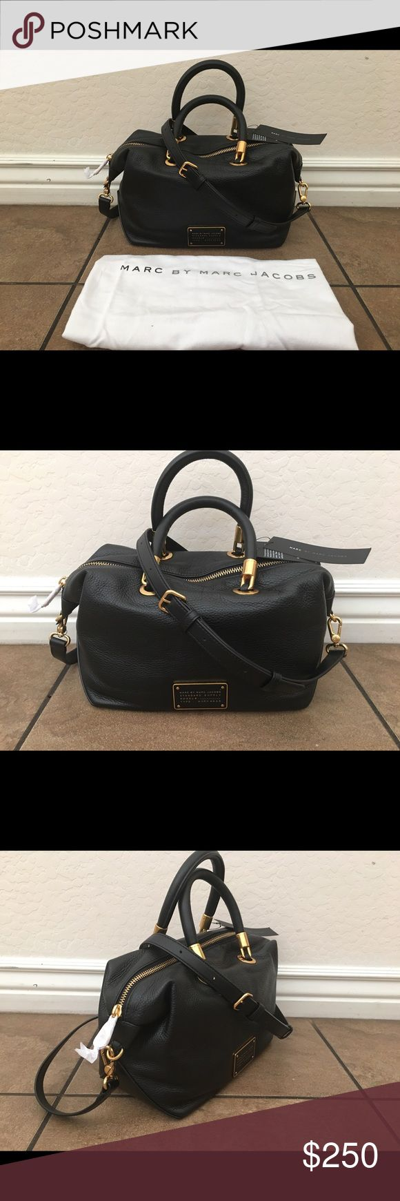 "NWT Marc Jacobs Too Hot To Handle Leather Satchel New with tags! 100% authentic. Color is black. Retail $398. Leather exterior with gold hardware. Dual straps, with longer adjustable shoulder strap. Marc Jacobs engraved plate on front. Interior includes one zipper pocket, and two slide pockets for storage. Measures approx. 11.5"" L X 5""D X 6.5""H Dual strap drop length measures approx. 5"" long  Adjustable shoulder strap drop length can measure up to approx. 23.5""  Dust bag included Marc by…"
