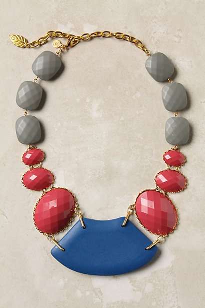 """Faceted beads and smooth wooden shapes in subdued and riotous shades offer a balance of color and texture.   Lobster clasp   Resin, wood, 18k gold plated metal   20""""L, 2""""W   USA"""