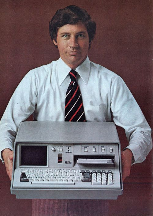 IBM Portable PC, model number 5100; First introduced: September, 1975;  CPU: IBM proprietary, 1.9MHz;  RAM: 16K, 64K max;  Display: 5″ monochrome monitor 64 X 16 text;  Storage: Internal 200K tape (DC300);  Ports: tape / printer I/O port;  OS: APL and/or BASIC.