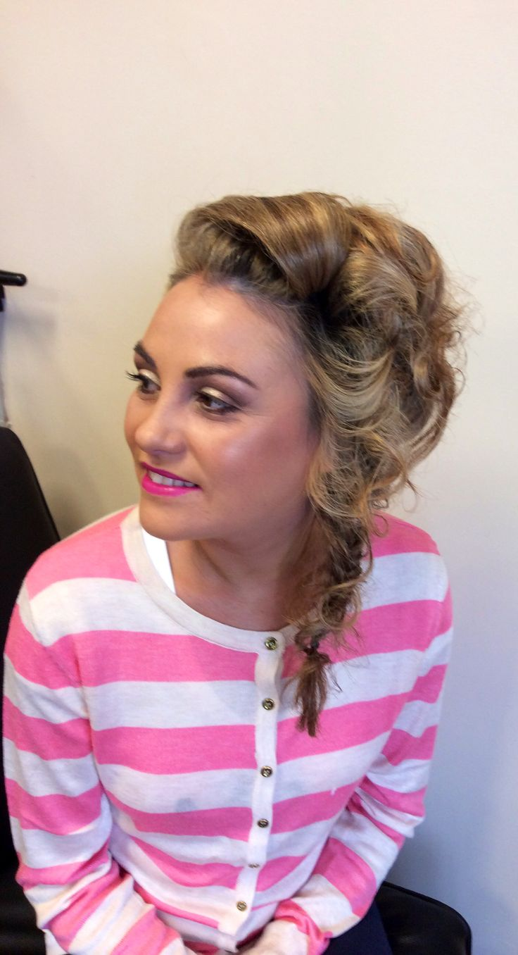 Updo to the side with curls and fishtail combined