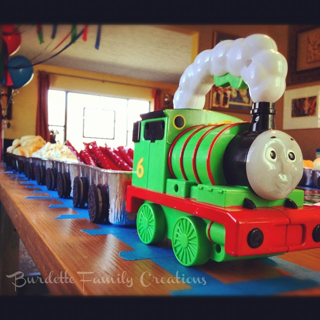 Thomas the Train Birthday Party — awesome ideas!!!  Blue painters tape for track; use images and toothpicks as cake toppers.