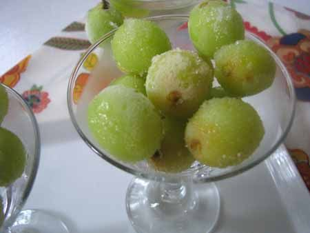 Wine-marinated grapes ~ Soak 1-1/2 lb seedless green grapes in white wine (1 bottle) mixed with 1/4 c sugar. After 24 hrs, scoop the grapes out, toss them with a few more tbsps sugar, and stick them in the freezer for a few hrs. Serve in martini glasses. Pour the wine marinade back into its original bottle, cork it up, and put in the fridge. Enjoy later as a sweet wine spritzer!