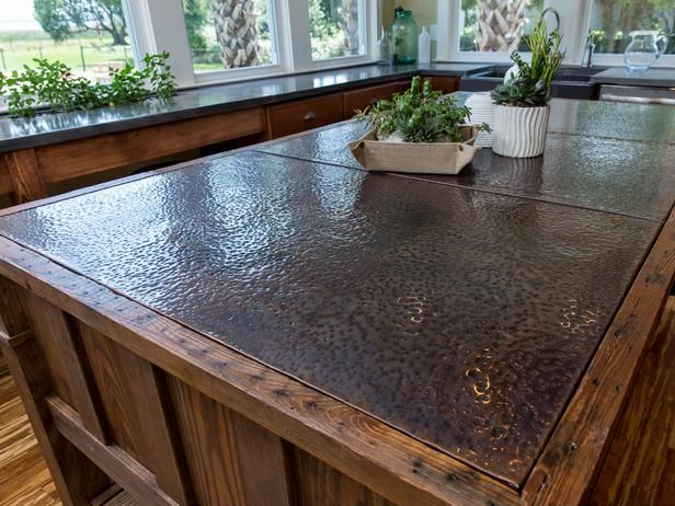 Credit: Eric Perry © 2014, DIY Network/Scripps Networks, LLC. All Rights Reserved.  On Island Time This show-stopping, copper-topped island has been constructed completely from reclaimed wood. The soft brown tones complement the warm cherry cabinetry completely.Kitchen Island