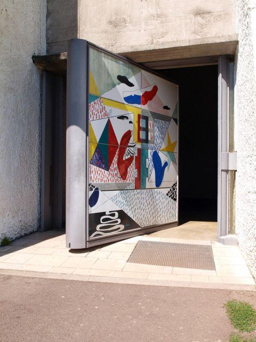 Main door to Notre Dame du Haut by Le Corbusier Image by joelsia.