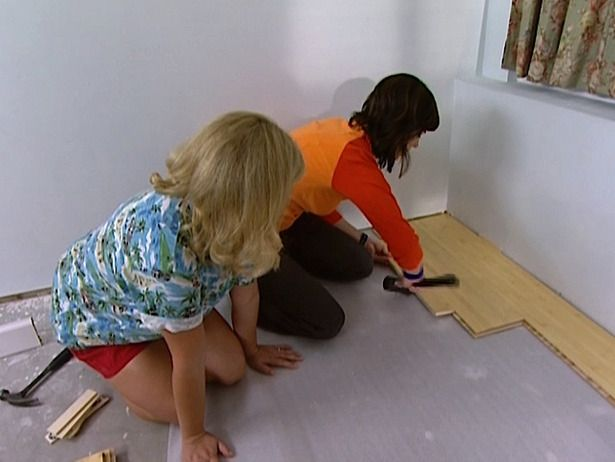 Installing laminate flooring.