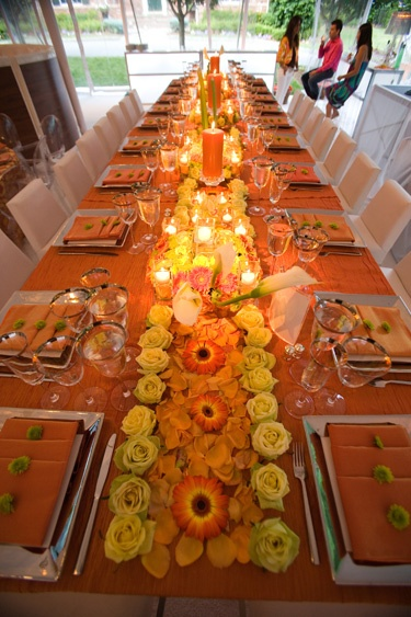 Beautiful table. Probably only for a smaller wedding or the wedding party table. But the roses center piece is amazing.