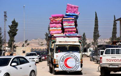 Latest dramatic photos from inside east Aleppo as Russian-backed government forces make huge gains:     Aleppo  -   Syria A Red Crescent vehicle carrying mattresses for people who fled east Aleppo is seen in a government-held-area of the city. Handout picture provided by the Syrian Arab News Agency (SANA).   SANA/Reuters