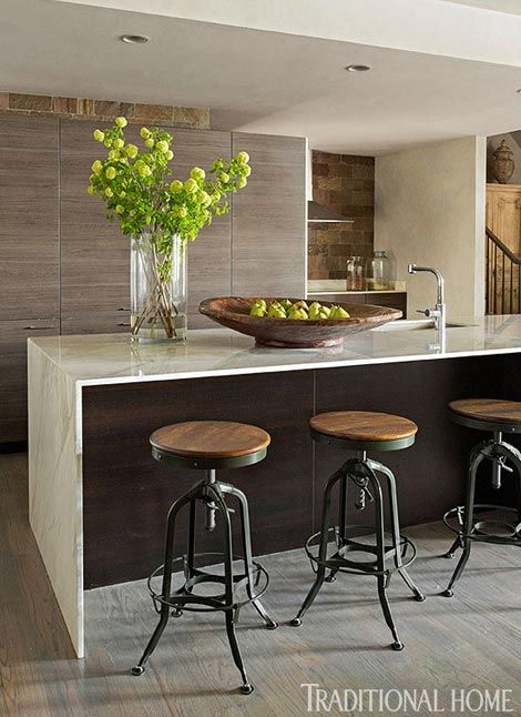 We love the simple and contemporary aesthetic of this kitchen - Traditional Home® / Photo: Eric Roth / Design: Joseph Abboud in partner with RH