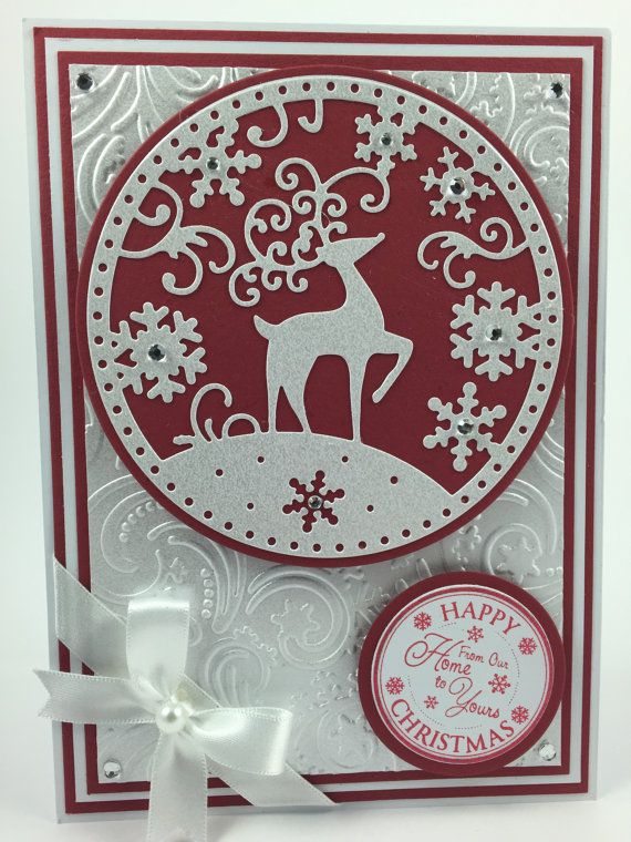 "An additional option for Christmas using the wonderful reindeer snowglobe design by Tattered Lace, this time in a 5"" x 7"" card. The card is available in eight different colour schemes which will dictate the background for the main snowglobe motif and the alternating layers of card. The card can also be printed inside with your own message if you'd prefer to have this printed for you, otherwise it will be left blank inside for you to write your own message."