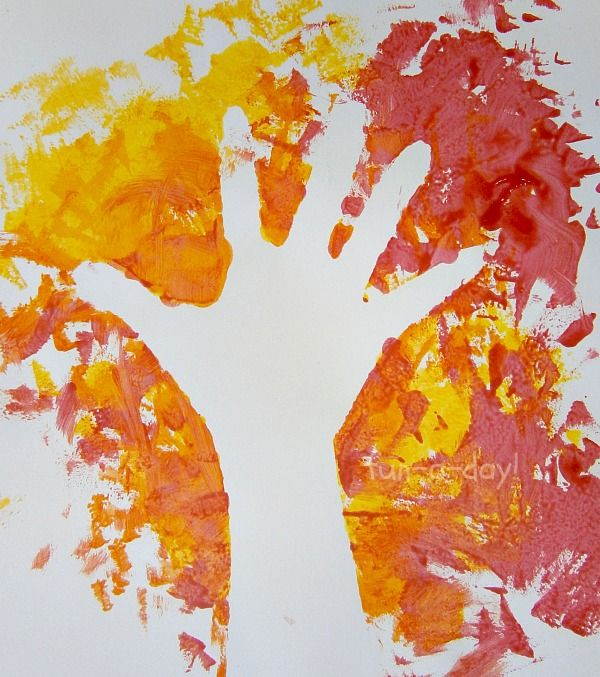 Fall Hand Print Art: Exploring Negative Space with Kids (from Fun-a-Day)