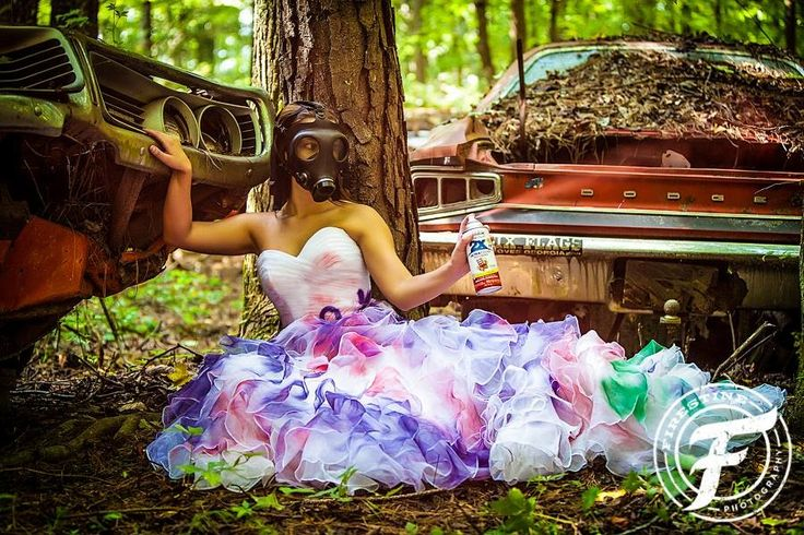 Wedding dress | spray paint | trash the dress photo shoot | gas mask | junkyard | antique cars | old car city | Firestine Photography | Atlanta, Ga