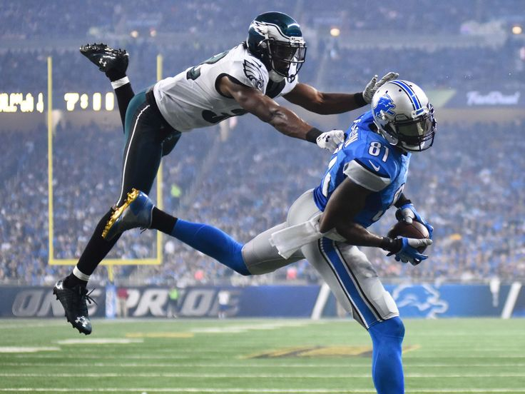 Detroit Lions wide receiver Calvin Johnson, right, scores a touchdown while being pressured by Philadelphia Eagles cornerback Eric Rowe during the third quarter of a NFL game on Thanksgiving at Ford Field.  Tim Fuller, USA TODAY Sports