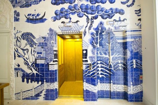 Only You Hotel in Madrid: {In order to camouflage the elevators in the reception area, Lazaro Rosa Violán had a blue and white Chinoiserie scene painted onto a tile wall.}: