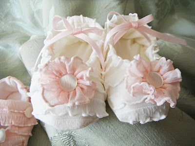 These little baby booties are handmade with darling mini ruffles.