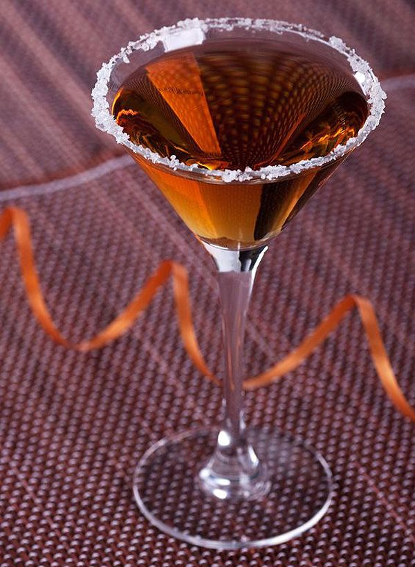 MAYHEM MARTINI ... Ingredients:    2 oz Cockspur Fine Rum  ½ oz triple sec  ½ oz Godiva Chocolate Liqueur  Orange twist for garnish.