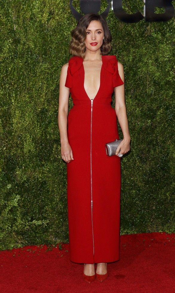Rose Byrne in a red Delpozo straight-line midi-length dress, Oroton clutch, and Brian Atwood red shoes