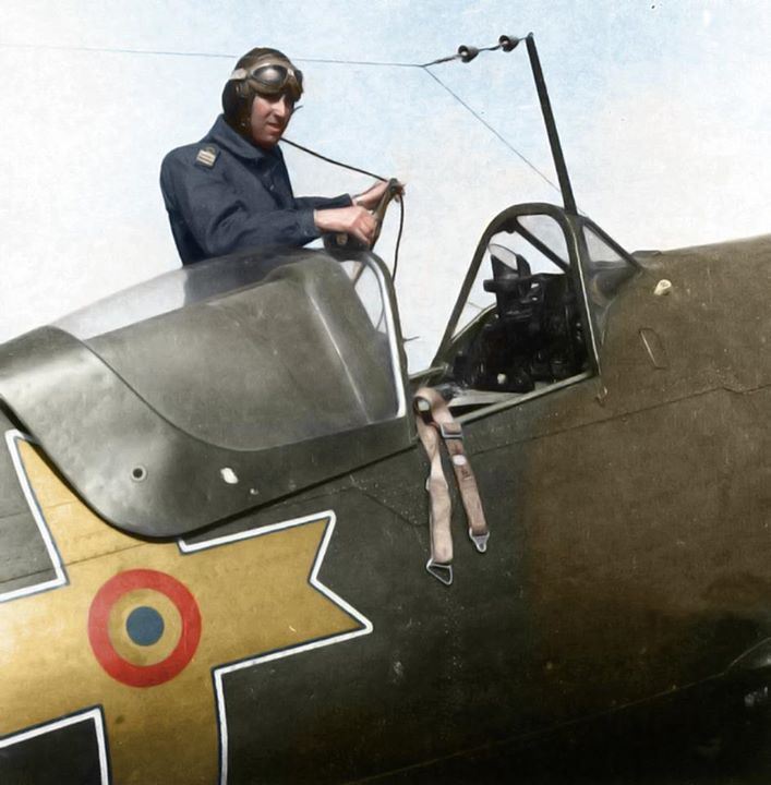 An unidentified Royal Romanian Airforce fighter pilot climbing aboard a (Industria Aeronautică Română) IAR-80 at an airfield in the Ploiești area, 35miles (56kms) north of Bucharest. c.1943. (Colourised by Doug)