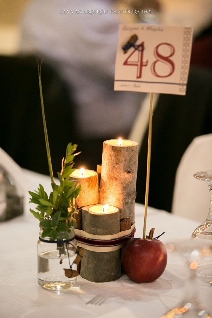 #Wedding #Table #CenterPiece: #Handmade #treebranch #candle #holders. Decorated maison #jars with #wild #flowers and candles, apple signing the #table #number. #Stationary designed by #GoldenAppleWeddings  #Events in #Rhodes #Island- #GREECE #savvasargirou wedding #photography